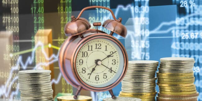 stacks of coins with the vintage clock over the LED display Stock market exchange data background, Business investment and trading concept