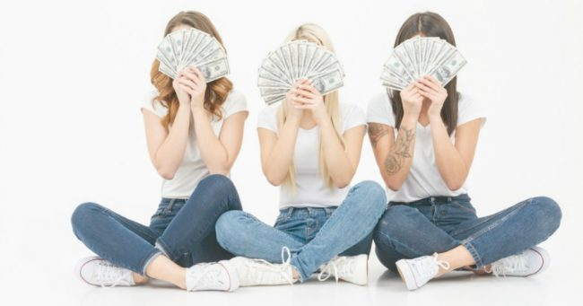 teens playing games with money