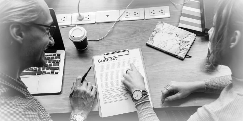 couple reviewing a rental agreement contract