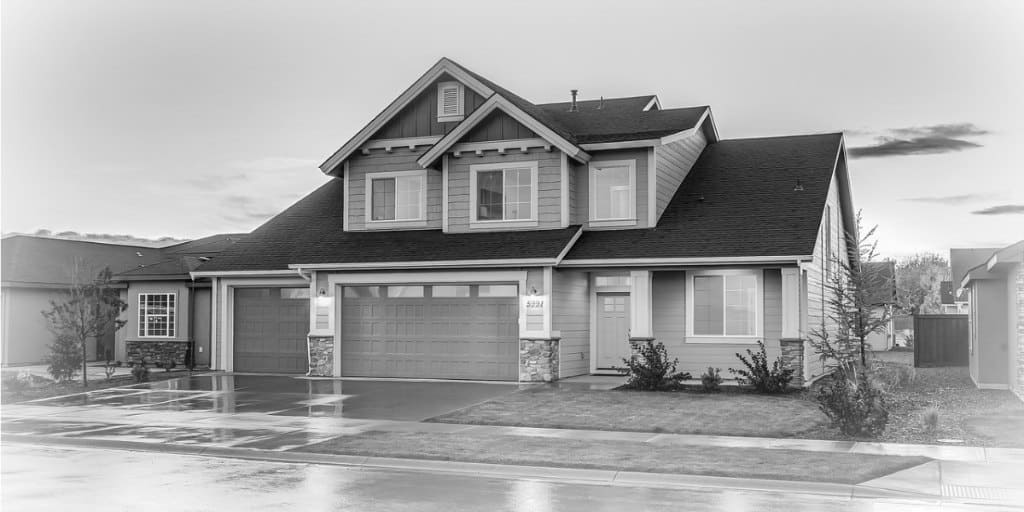 black and white exterior photo of a two story home