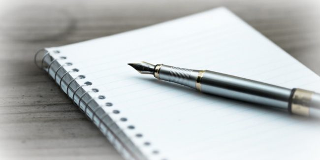 fountain pen and notebook to take notes for emergency document information