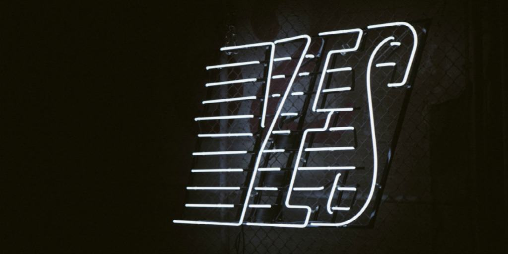 graphic of the word yes, letters outlined in white against black background