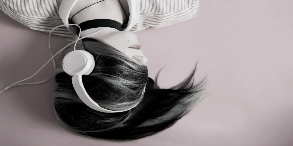 dark haired woman with her hair wrapped around her head and headphones on 2
