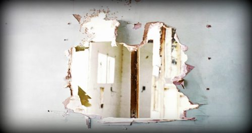 a hole smashed in the interior wall of a house