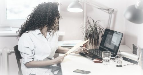 women working at a home office desk