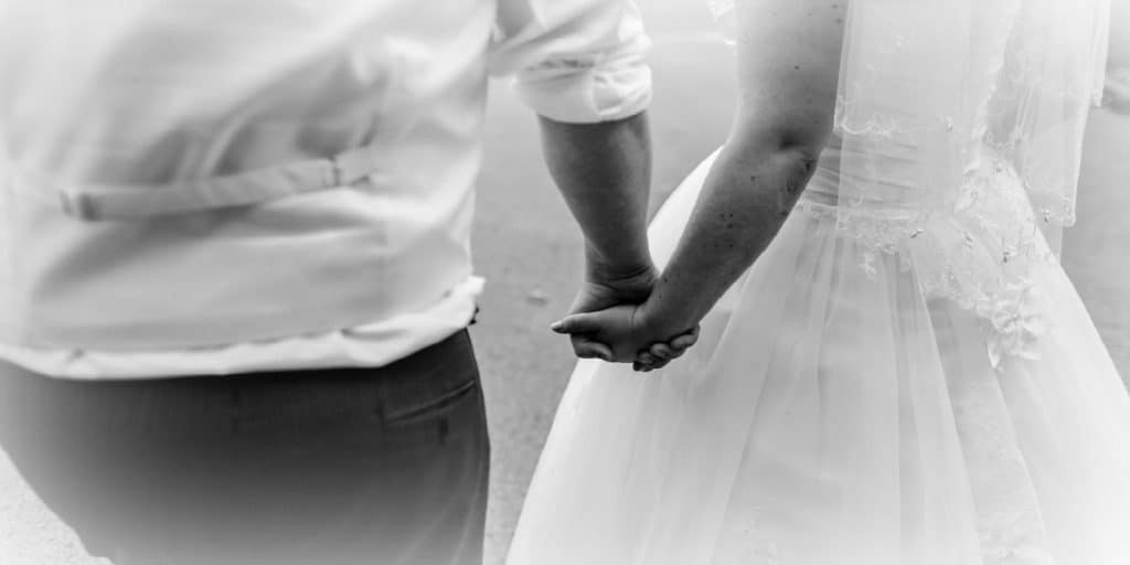 new bride and groom holding hands
