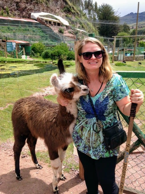 Bonnie Truax with a llama in Peru