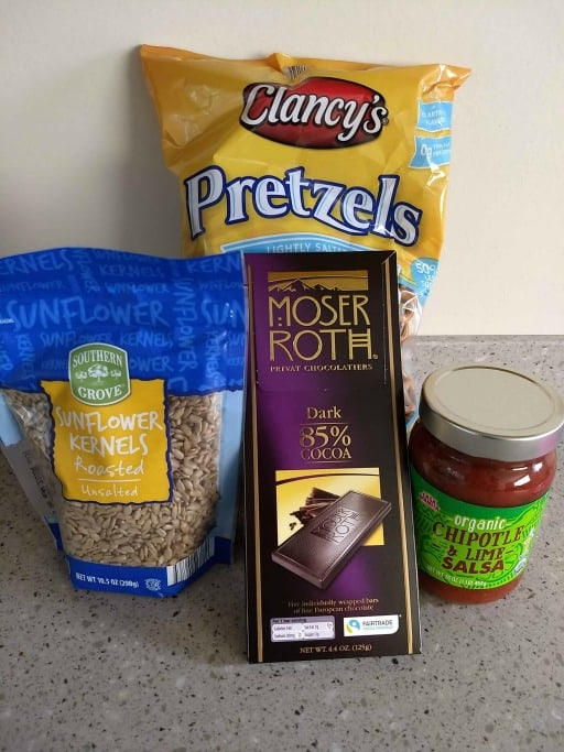aldi food products, mini pretzels, chocolate bar, salsa, and sunflower seeds