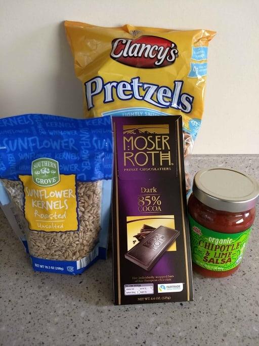 aldi food products, mini pretzels, chocolate bar, salsa, and sunflower seeds