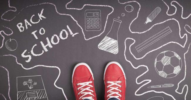 back to school written on chalk board