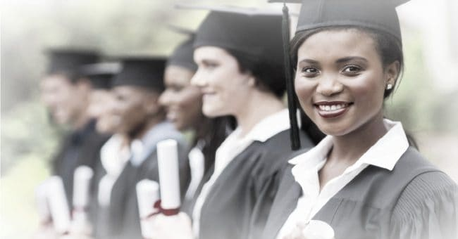 female and classmates graduating from college