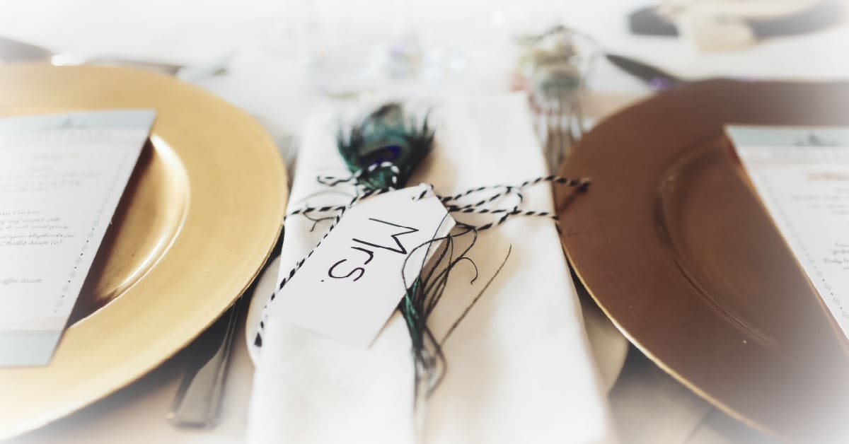 dinner table place setting with a Mrs. tag