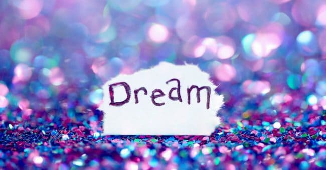 the word dream writing on a torn piece of paper