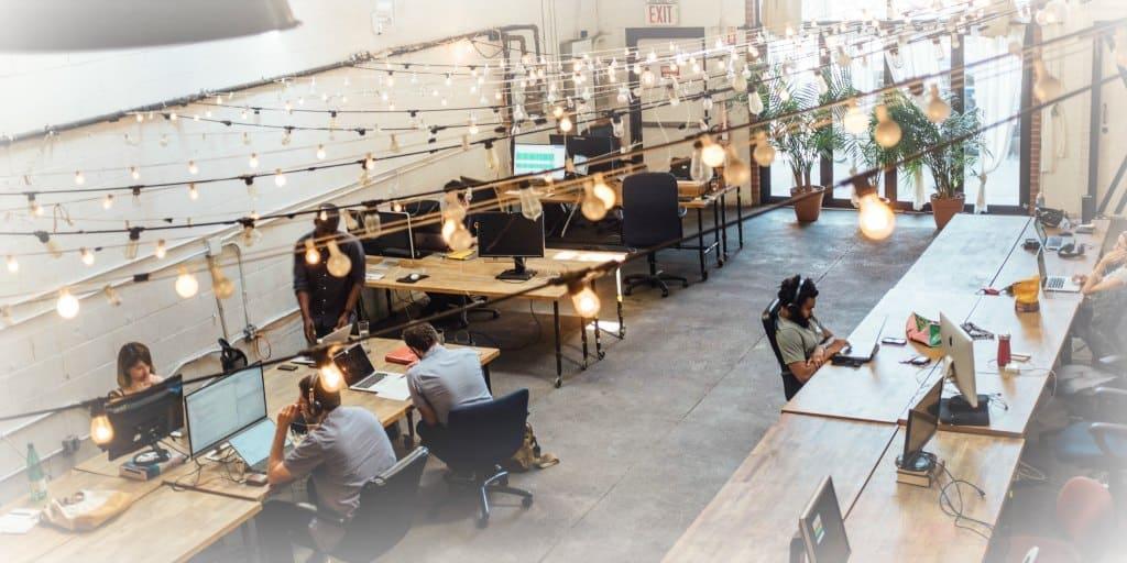 overhead shot of a workforce in an open office setting