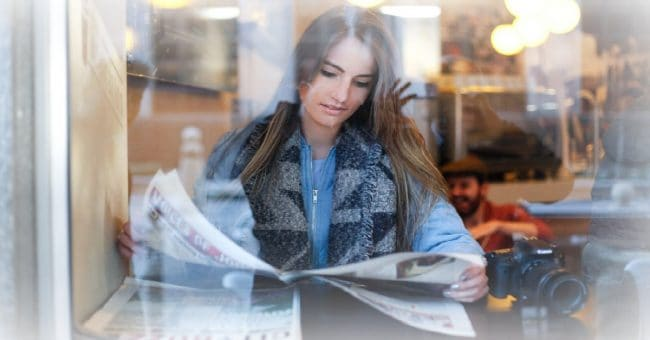 woman reading the money news
