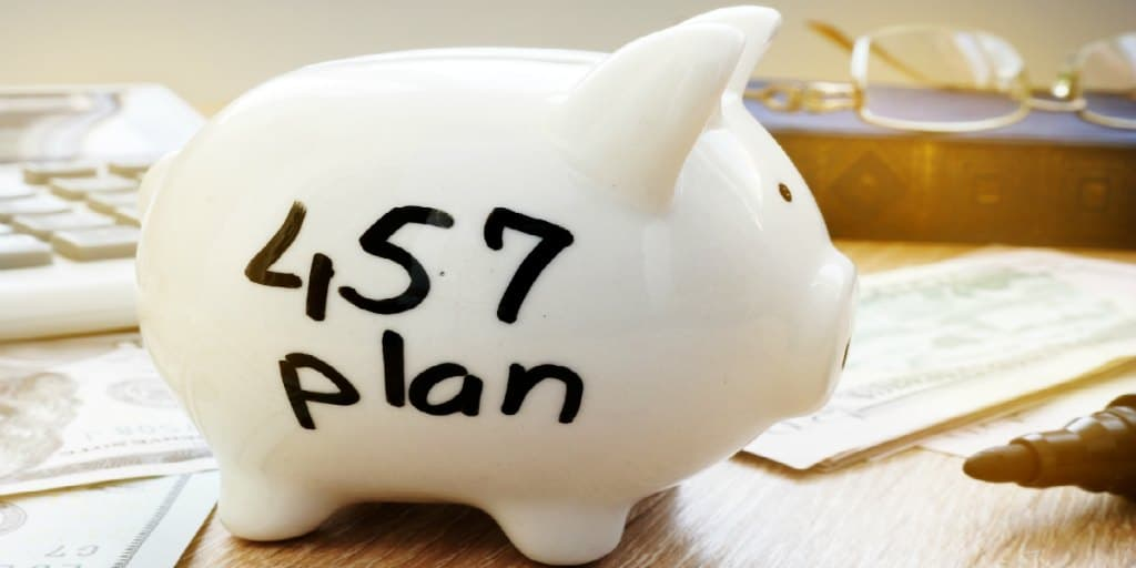 457 plan written on a side of piggy bank.