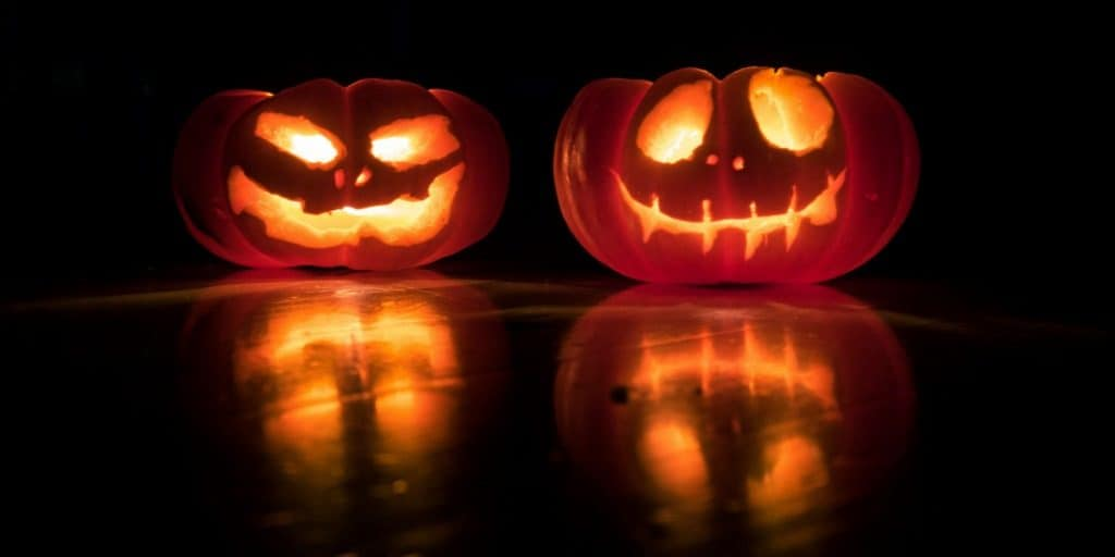 two lit carved pumpkins
