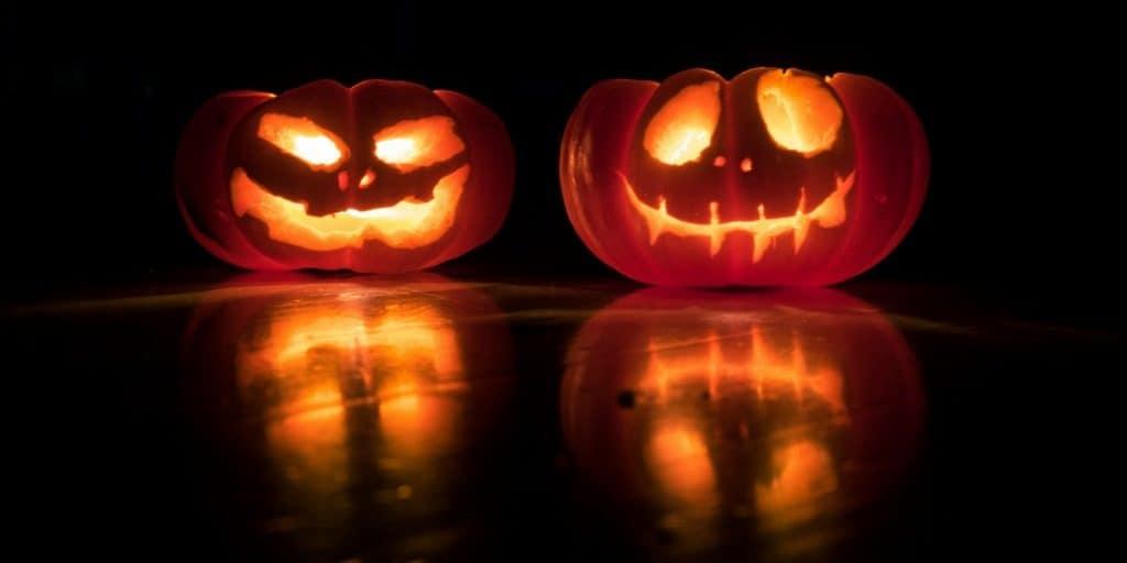 two lit carved pumpkins