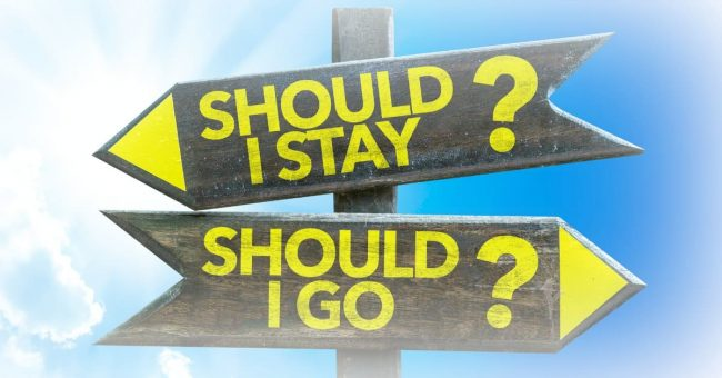 road signs - asking about moving to a lower cost of living area - should I stay or should I go