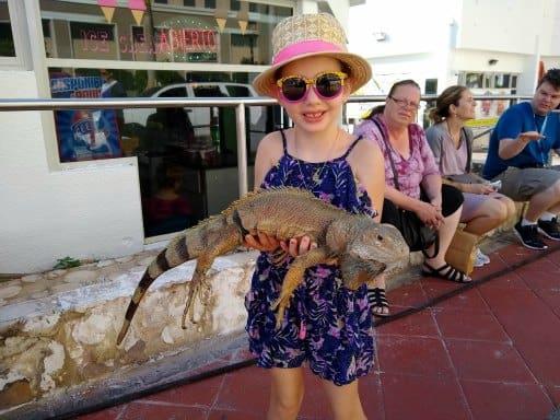 inspiring money story Faith - holding a large iguana