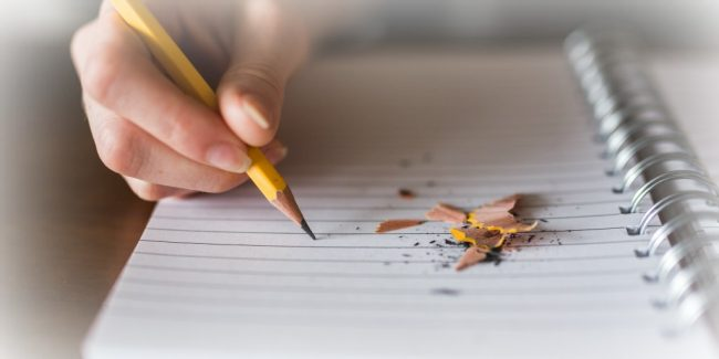 writing out a budget in a notebook