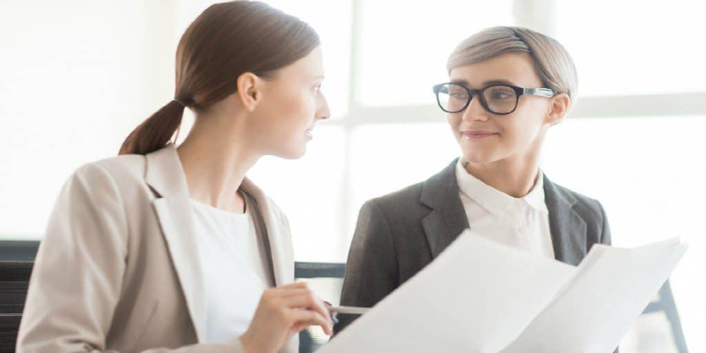 two female financial professionals conversing