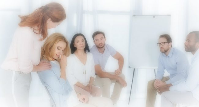 a small group of people comforting a woman over money troubles