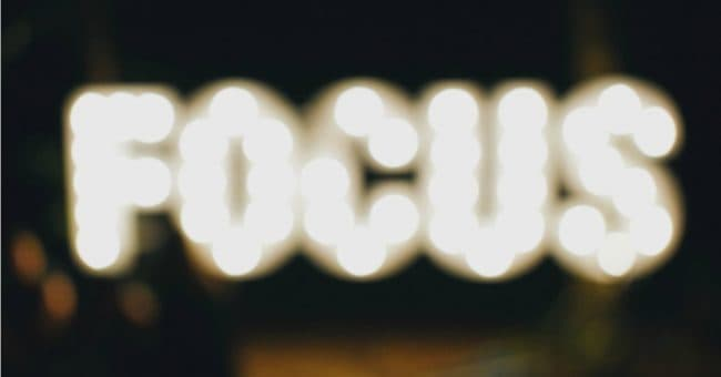 the word focus in bright lights out of focus