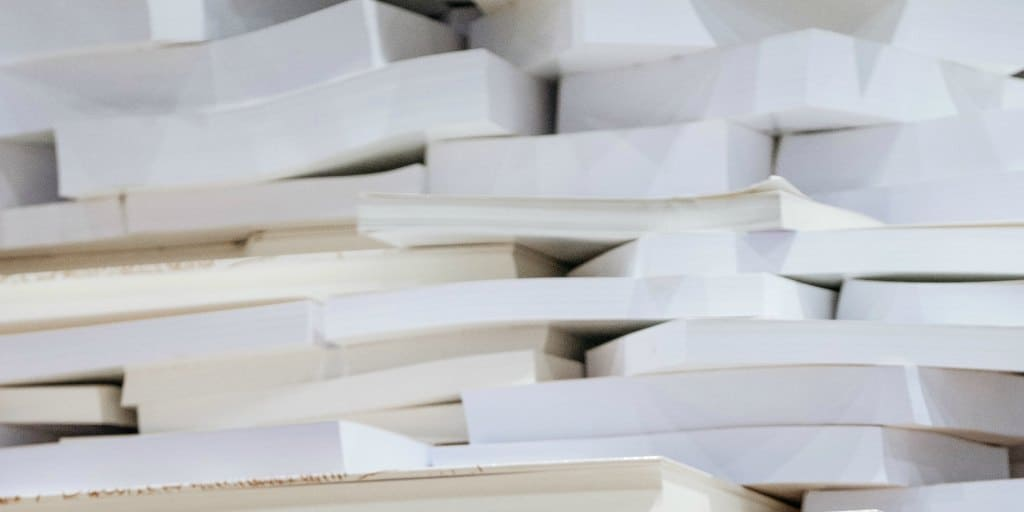 stacks of white papers and books