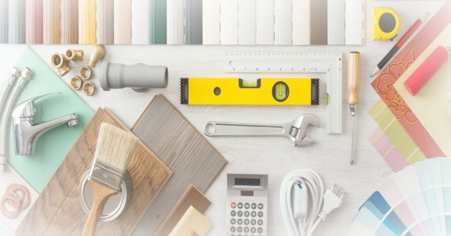 level, wrench, calculator, paint samples, and other items needed for home renovation projects
