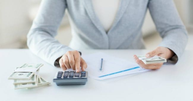 woman calculating investment returns on tax liens