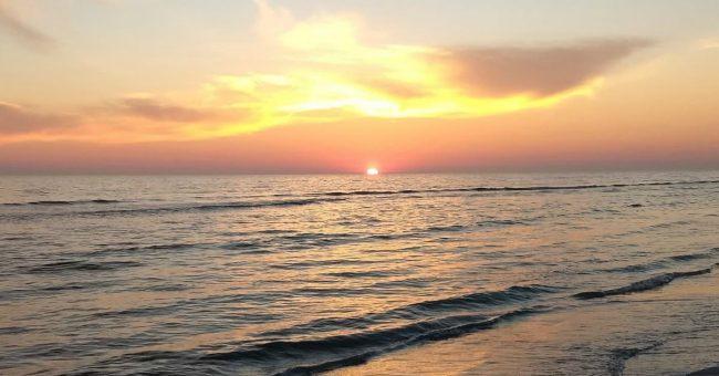 sun setting over the gulf coast