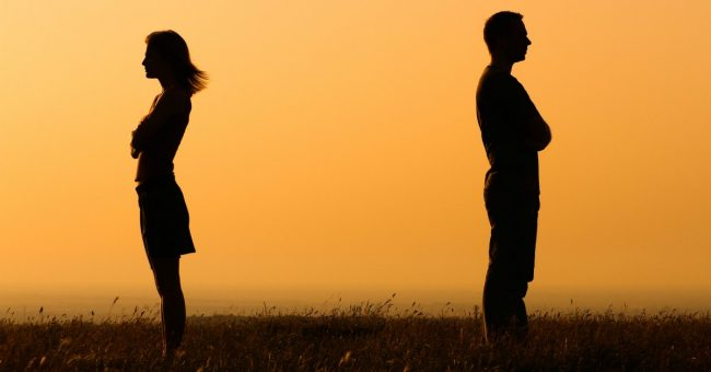 silhouette of a couple with backs to each other