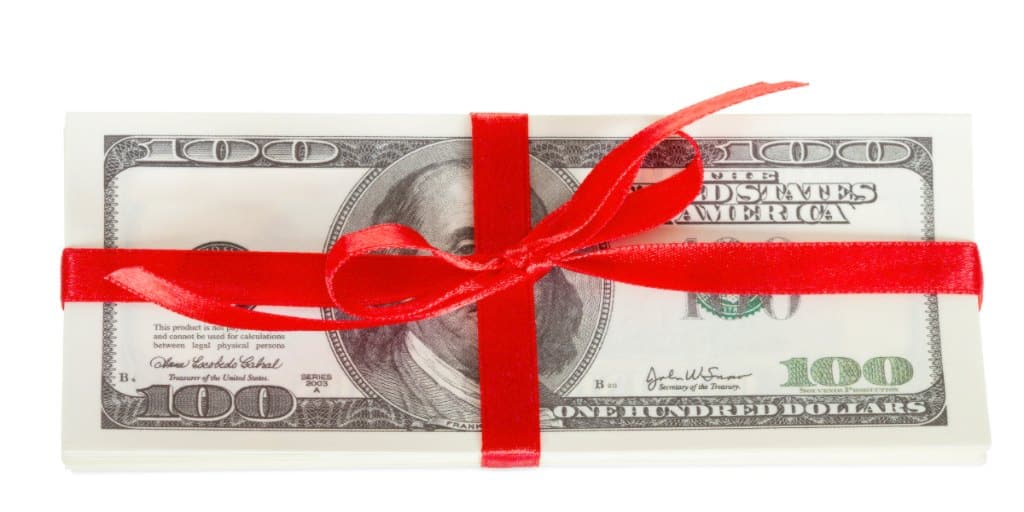 Pack of dollars wrapped as a gift earned as a bank bonus