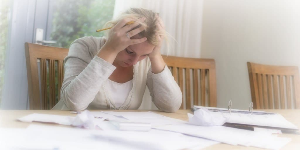 women stressed out by debt considering bankruptcy 2
