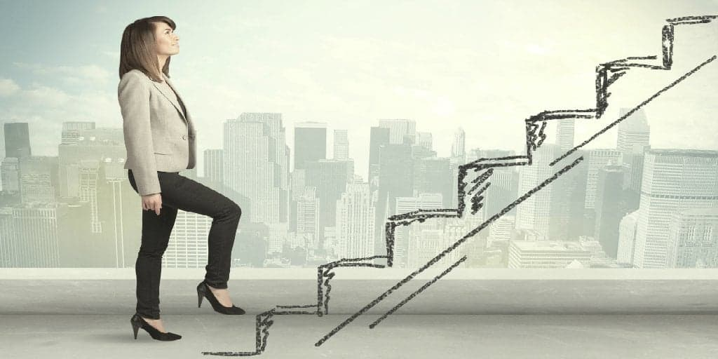 woman climbing a hand drawn staircase representing a career path