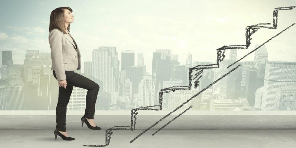 woman climbing a hand drawn staircase representing a career path