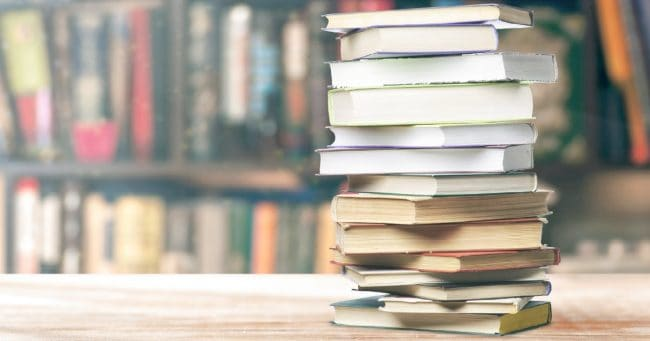 stack of the best money books for teens and young adults