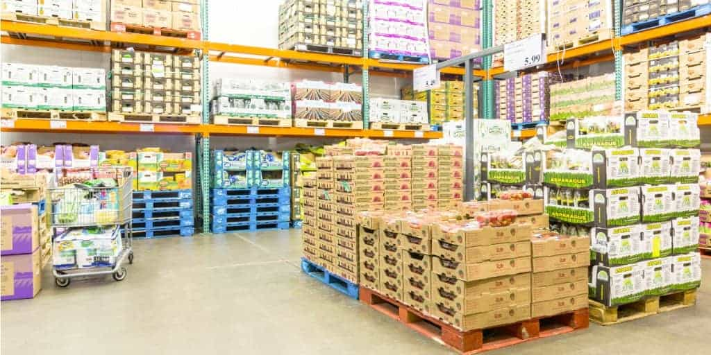 inside view of a warehouse club with pallets of products