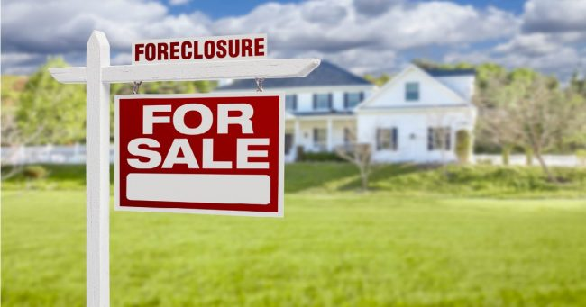 foreclosure for sale sign in front of a home