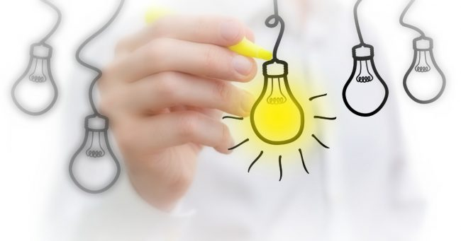 light bulbs hanging from a string representing a list of business ideas