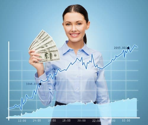 young woman holding cash she earned in the stock market