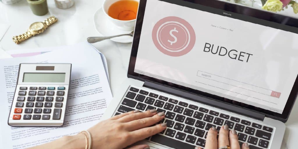 women working on a budget on her laptop