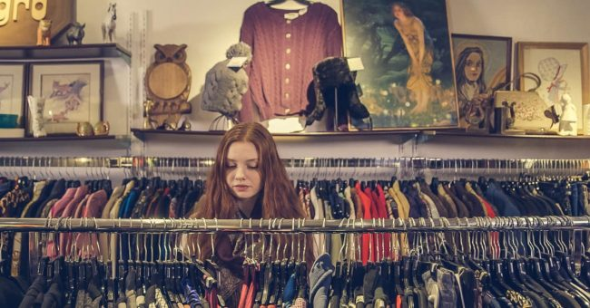 young woman shopping in second hand store