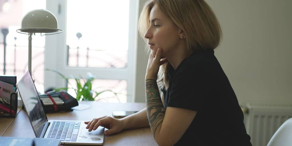 woman working on her side hustle at her laptop