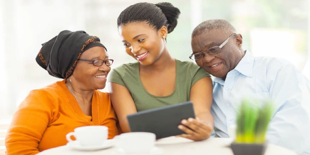 female showing her parents financial information on her tablet