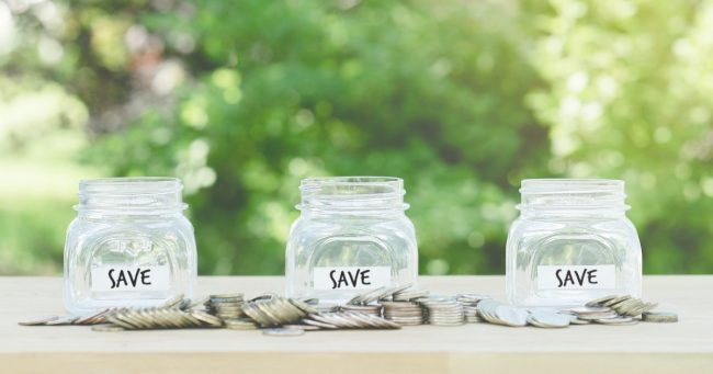 three glass jars to save coins in