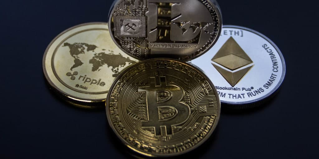 four different cryptocurrency coins