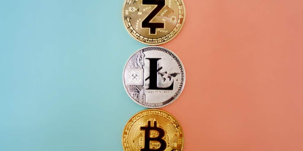 3 coins representing 3 different cryptocurrencies