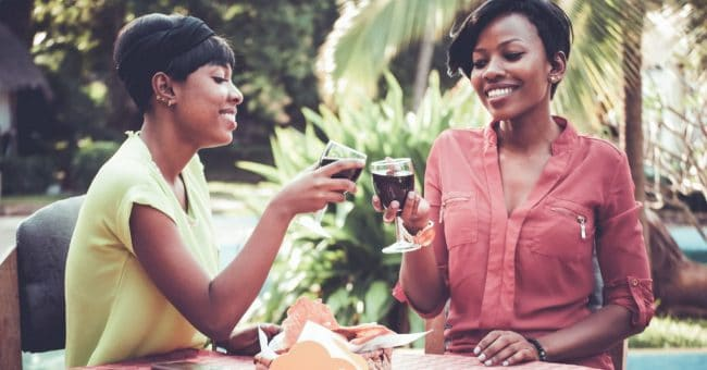 two women toasting their friendship over wine 1